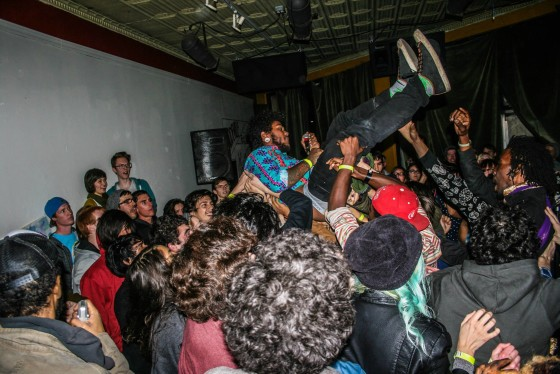 Photo by Jeff Schaer-Moses  Wolvves frontman Aydin Immortal crowd surfing for the first time during a performance at Phoenix Arizona's Trunk Space.